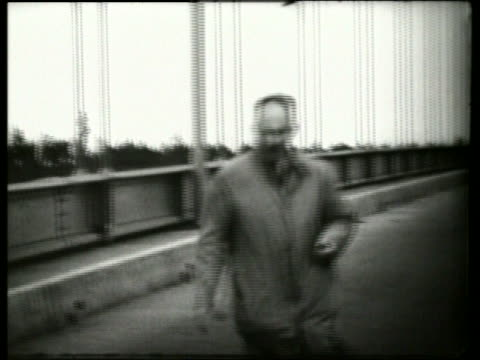 B/W 1940's man walking on swaying buckling bridge / Galloping Gertie / Tacoma Narrows Bridge / SOUN