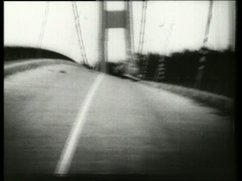 B/W 1940's man walks on swaying buckling bridge with car / Galloping Gertie / Tacoma Narrows Bridge /