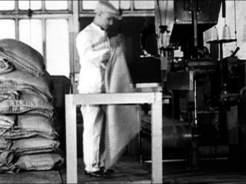 1920's - man weighs sack of coffee beans - one mid adult man only stock videos & royalty-free footage