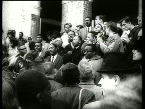 b/w 1960's martin luther king in crowd at demonstration / selma alabama / sound - martin luther religious leader stock videos & royalty-free footage