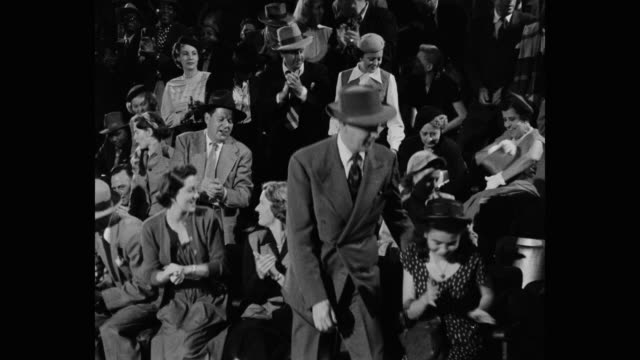 1950's - medium shot of crowd clapping and leaving sport venue - sport venue stock videos & royalty-free footage