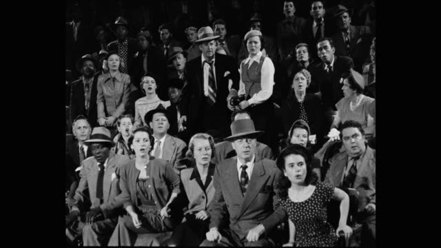 1950's - medium shot of crowd reacting while watching sport event - surprise stock videos & royalty-free footage