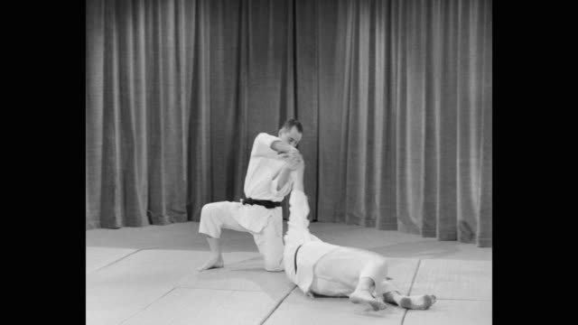 1960's - medium shot of men doing martial arts - martial arts stock videos & royalty-free footage