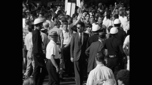 1960's medium shot of protestors protesting on street, los angeles, ca, usa - talking politics stock videos & royalty-free footage