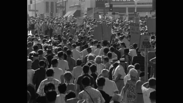 1960's medium shot of protestors protesting on street, los angeles, ca, usa - friedensdemonstration stock-videos und b-roll-filmmaterial