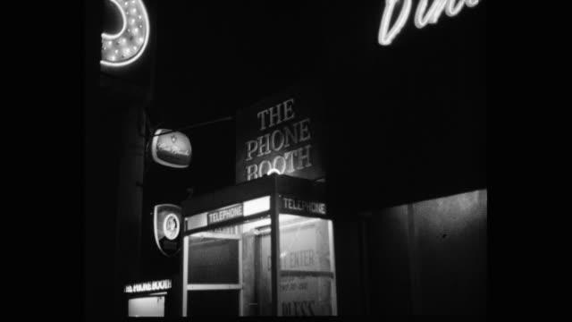 1950's - medium shot of telephone booth at night, los angeles, ca, usa - telefonzelle stock-videos und b-roll-filmmaterial