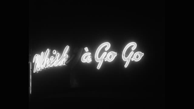 1950's - medium shot of whisky a go go nightclub sign at night, west hollywood, california, usa - west hollywood stock videos & royalty-free footage