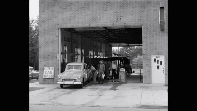 1950's - men washing car in garage - car wash stock videos & royalty-free footage