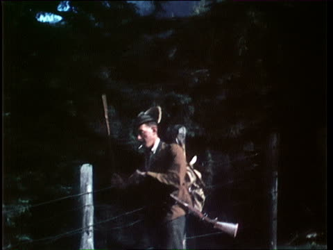 1940's MONTAGE Man coming back from hunting, carrying dead carcass of hunted deer on back / Tyrol, Austria