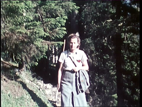 1940's montage mother and son walking in mountains, son carrying hunting gear / tyrol, austria - austria stock videos & royalty-free footage