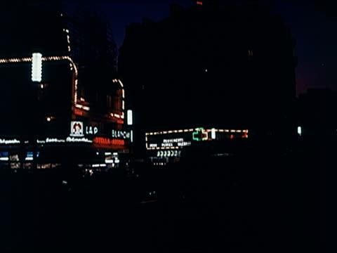 vidéos et rushes de 1960's - montage, neon signs at night in montmartre - vie nocturne