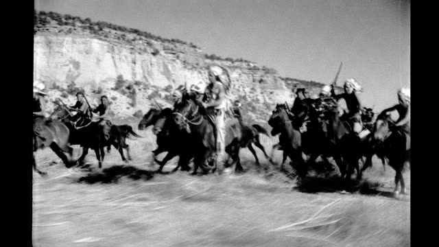 vídeos de stock e filmes b-roll de 1930's - native americans on horseback - cultura tribal da américa do norte