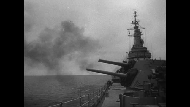 1940's naval officers issue commands to operators to fire - battleship stock videos & royalty-free footage