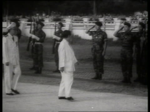 b/w 1960's ngo dinh diem walking past soldiers / s vietnamese president / saigon / sound - south vietnam stock videos & royalty-free footage