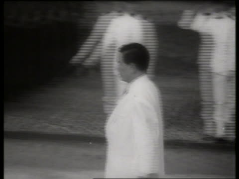 b/w 1960's ngo dinh diem walking past soldiers / s vietnamese president / saigon / sound - only mid adult men stock videos & royalty-free footage