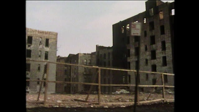 gv's of burnt buildings and rundown streets; new york, 1975 - debt stock videos & royalty-free footage