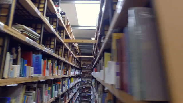 s of second hand books on shelves in somerset warehouse, that normally sells to film sets, but during coronavirus pandemic is selling to people who... - bookshelf stock videos & royalty-free footage