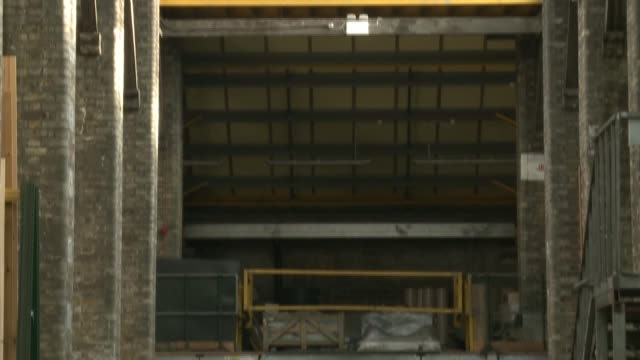 uk's oldest timber yard to be demolished by developers england london belgravia int ceiling tilt down man along at newson's timber yard general view... - itv london lunchtime news点の映像素材/bロール