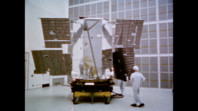 / nasa's orbiting astronomical observatory satellite in production / animation of satellite in space / oao will carry ultraviolet and xray telescopes... - radiation stock videos & royalty-free footage
