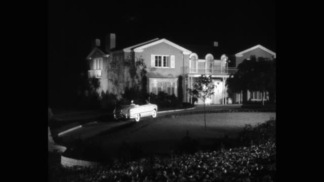 1950's - panning shot of car arriving at mansion, los angeles, california, usa - stately home stock videos & royalty-free footage