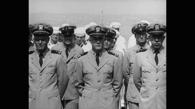 1950's - panning shot of navy officers and sailors standing on warship - us military stock videos & royalty-free footage