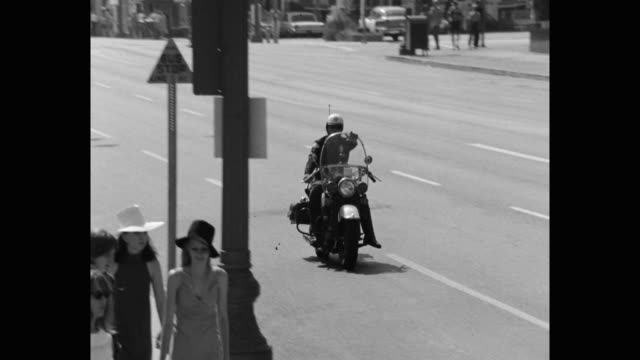 1960's panning shot of police officer riding police motorcycle on street, los angeles, ca, usa - talking politics stock videos & royalty-free footage