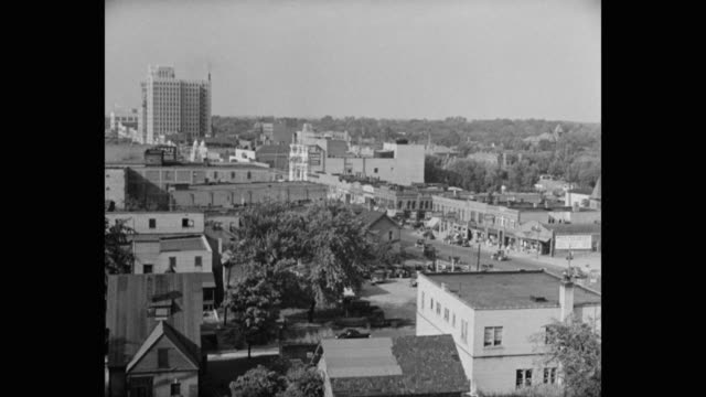 1950's panning shot of pontiac cityscape, michigan, usa - michigan stock videos & royalty-free footage