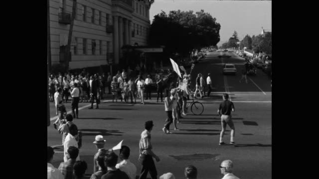 1960's panning shot of protestors protesting on street, los angeles, ca, usa - identity politics stock videos & royalty-free footage
