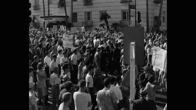 1960's panning shot of protestors protesting on street, los angeles, ca, usa - protestor stock videos & royalty-free footage