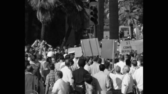 1960's panning shot of protestors protesting with placards on street, los angeles, ca, usa - talking politics stock videos & royalty-free footage
