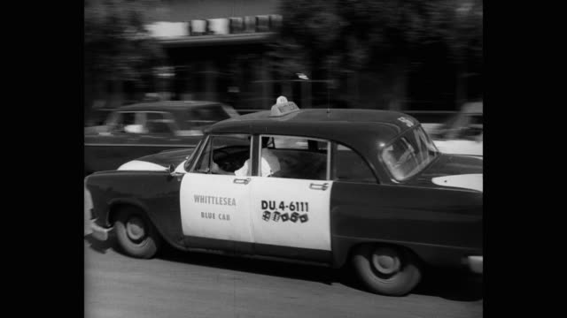 1960's - panning shot of taxis arriving at hotel, las vegas strip, las vegas, nevada, usa - taxi stock videos & royalty-free footage