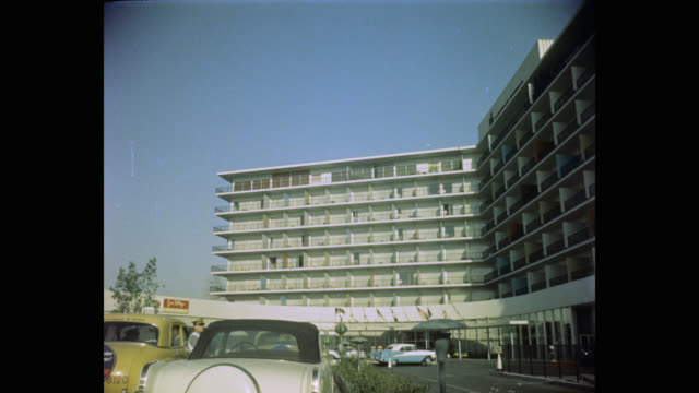 1950's panning shot of the beverly hilton hotel, california, usa - the beverly hilton hotel stock videos & royalty-free footage