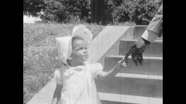 1940's - parents with their babies coming out of church building, greenwood, tulsa, oklahoma, usa - african american culture stock videos & royalty-free footage