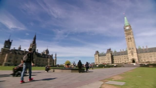 gv's parliament hill in ottawa with canadian flag flying - parliament hill stock videos & royalty-free footage