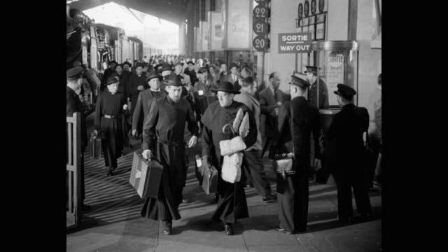 1950's - passengers getting off train and walking towards gate at railway station platform, france - waiting stock videos & royalty-free footage