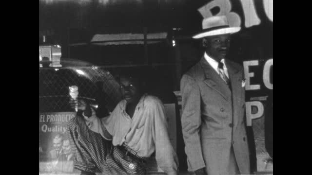 1940's - people and businesses of greenwood, tulsa, oklahoma, usa - アメリカ黒人の歴史点の映像素材/bロール