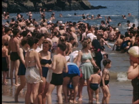 1940's people on beach and in ocean on crowded beach / coney island - coney island brooklyn stock videos and b-roll footage
