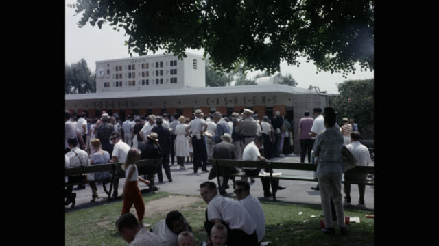 1950's - people waiting in line outside ticket counter at santa anita park, arcadia, california, usa - ticket counter stock videos & royalty-free footage