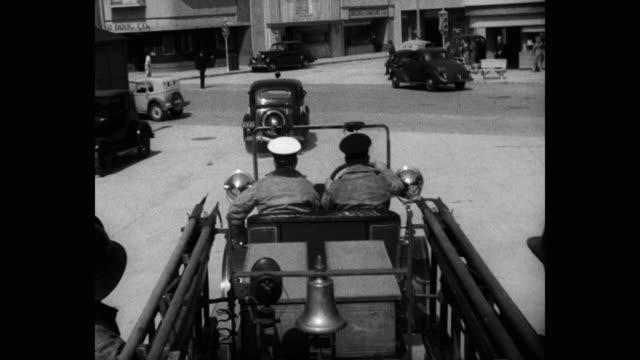 1940's - point of view of fire engine driving on street - 撮影現場点の映像素材/bロール