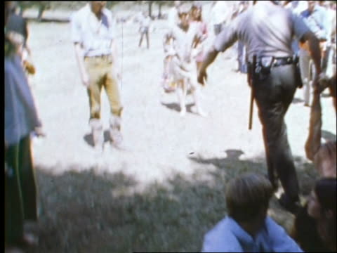 1960's police picking up handcuffed man from ground / hippies at bein - peace demonstration stock videos and b-roll footage