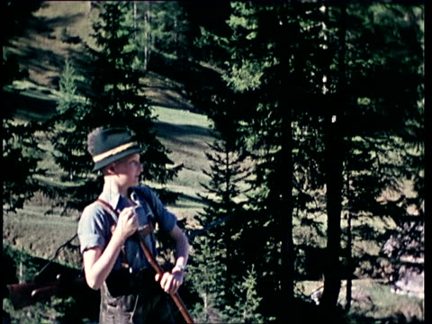 1940's ms portrait of teenage boy with hunting outfit / tyrol, austria - austria video stock e b–roll