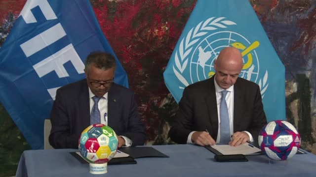 vídeos de stock, filmes e b-roll de fifa's presient gianni infantino and the world health organiztion's director general tedros adhanom meet in geneva to sign an agreement between the... - gianni infantino