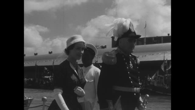uk's princess margaret on board royal yacht britannia / shot of britannia sailing into port louis / boats following yacht / margaret walks off barge... - owner stock videos & royalty-free footage