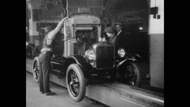 1920's production line workers assembling car chassis in ford motor company assembly plant, michigan, usa - car plant stock videos & royalty-free footage