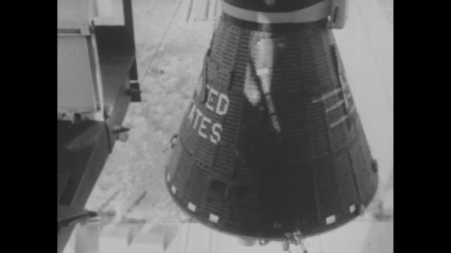 nasa's project mercury / mercury capsule being loaded onto atlas missile / note exact day not known documentation incomplete - 1950 1959 stock-videos und b-roll-filmmaterial