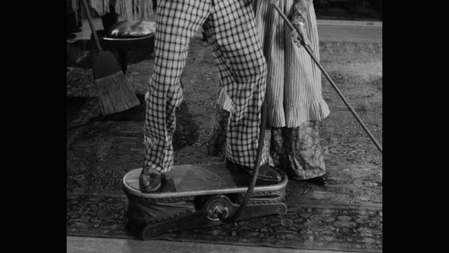 1910's recreation - tilt up shot of couple cleaning floor with vacuum cleaner - 1910 stock videos & royalty-free footage