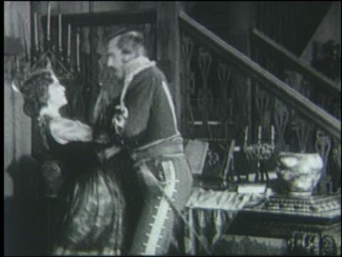 b/w 1800's reenactment woman slaps man in military uniform near stairs / 1920 - 19世紀点の映像素材/bロール