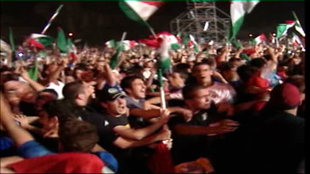 s revival; tx 10.7.2006 ???: ext at night italian football fans celebrating world cup final victory - final round stock videos & royalty-free footage