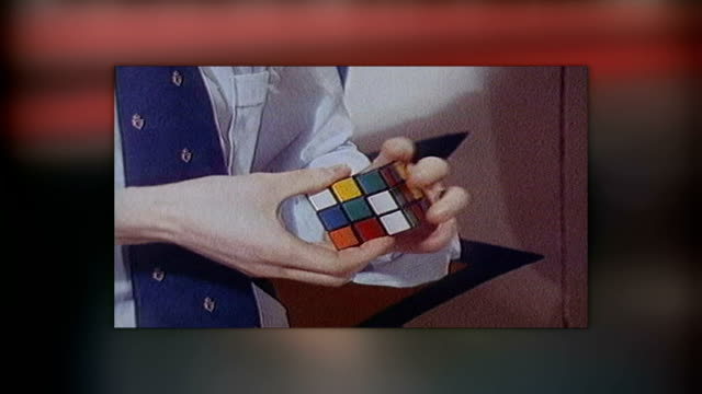 1980's revival tx rubik's cube being played with dissolve to - 1980 stock videos & royalty-free footage