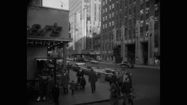1950's - rockefeller center seen from w 49th st and 6th avenue, new york state, usa - radio city music hall stock videos & royalty-free footage